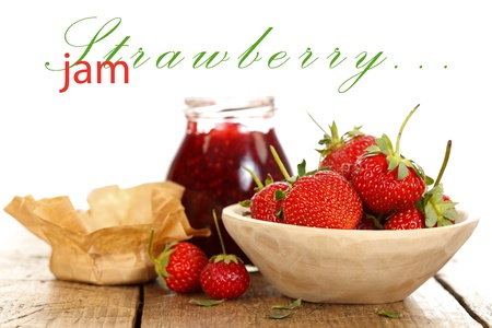 Strawberries in a wooden bowl with homemade jam, rustic style with place for your text up photo