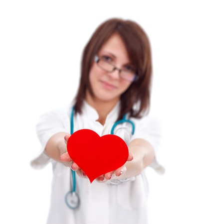 Female doctor offering a red heart to us photo