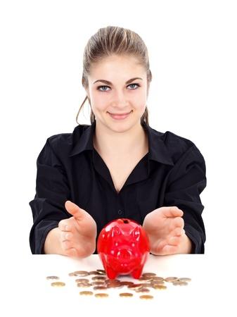 Woman protecting the piggy bank, symbol of savings photo