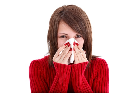 caucasian fever: Sick woman blowing her nose, white background Stock Photo