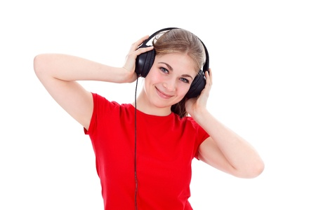 Girl with headphones listening music over white background photo