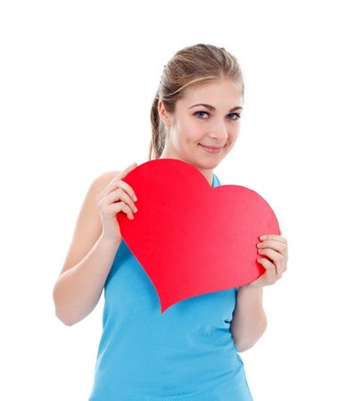 Girl with big red paper heart in her hand photo
