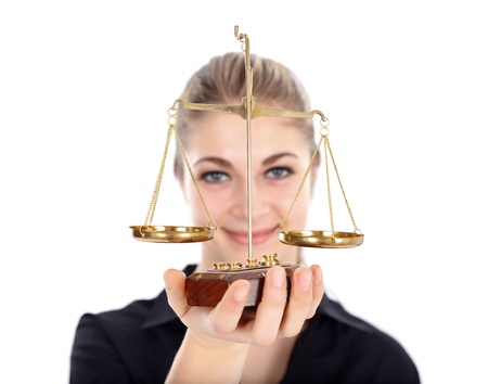 Woman holding scale of justice photo