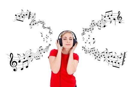 Girl listening music on headphones, music notes around photo