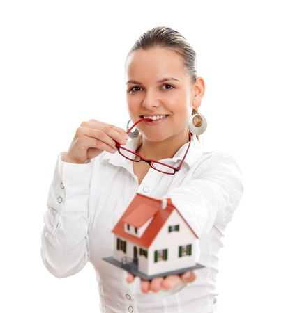 Woman offering a miniature house to us, white background
