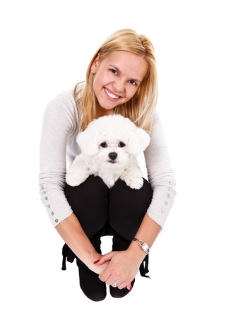 Smiling young woman with her little puppy Stock Photo - 12892350
