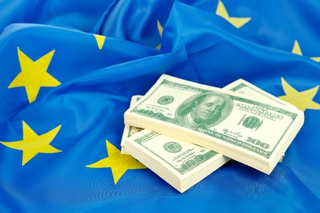 A heap of US dollars on the flag of the EU  photo