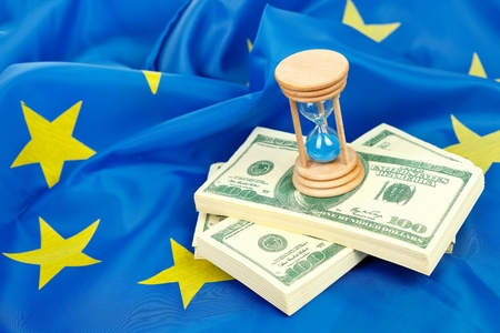 Hour-glass with US dollars on the flag of the EU  photo