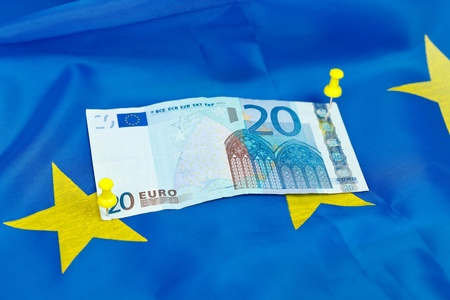 Euro beeing pinned down to an EU flag