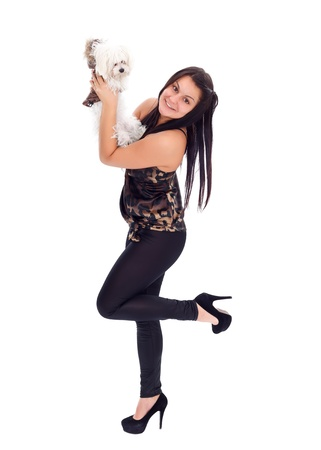Young woman showing her little puppy, white background