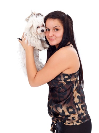Young woman holding her little puppy, white background