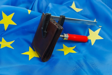 Wallet beeing squeezed in a vise, EU flag background