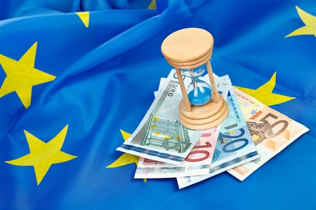 Hour-glass with euros on the flag of the EU  photo