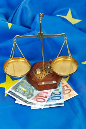 EU flag with scale of balance and euros  photo