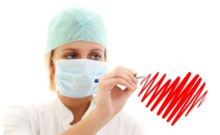 Medical nurse in mask writing red heart