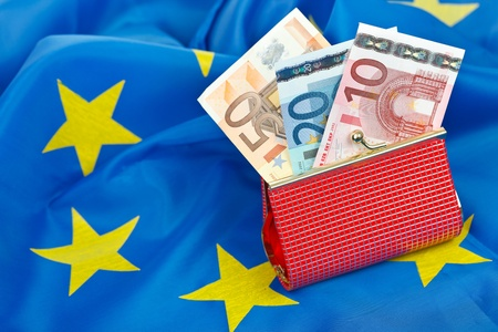 Euros in wallet on the flag of the European Union Stock Photo - 12912418