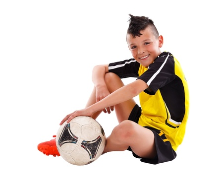 Teenage boy with soccer ball, studio shot  Stock Photo