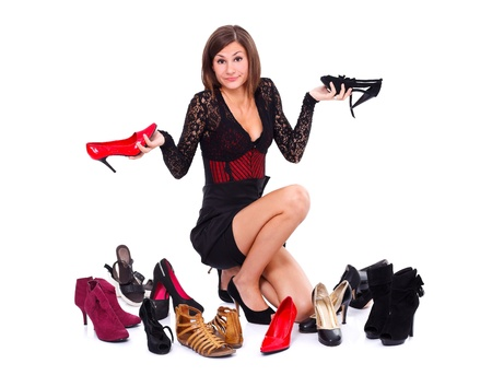 indefinite: Hesitant woman with her shoes over white background