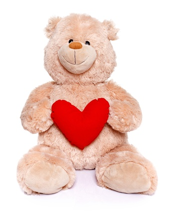 Brown teddy bear sitting and holding red heart photo