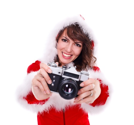 mrs  santa: Young smiling Mrs. Santa with retro camera in hand