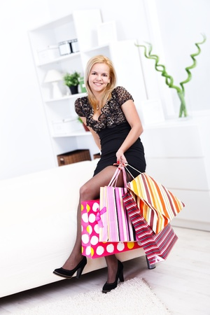 Woman holding shopping bags at home Stock Photo - 16411813