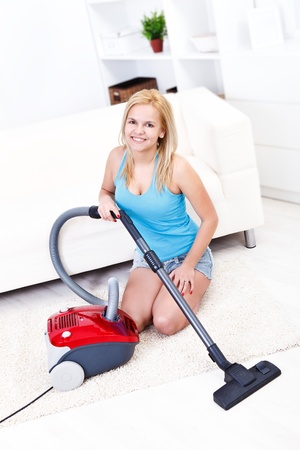 Sexi housewife using vacuum cleaner Stock Photo - 16411863