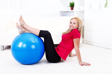 Woman stretching her legs on pilates ball at home Stock Photo - 16411859