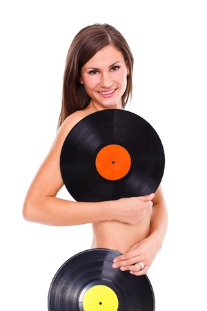 Nude girl with two vinyl discs in front of her, white background  photo