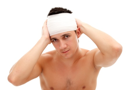 Young man with bandage on his head isolated on white background  photo