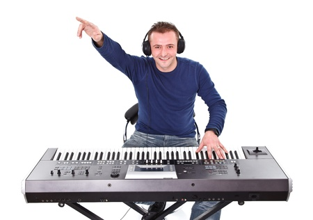 Portrait of a young smiling man with headphones and keyboard