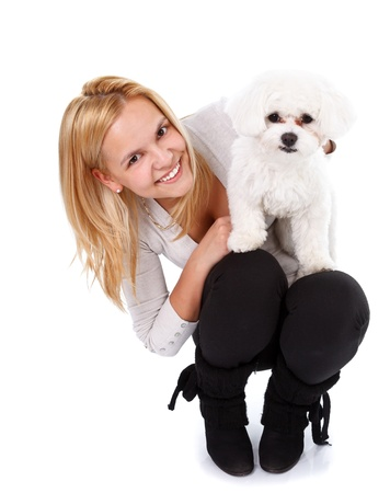 bichon bolognese: Beautiful smiling girl holding her lovely bichon puppy - isolated
