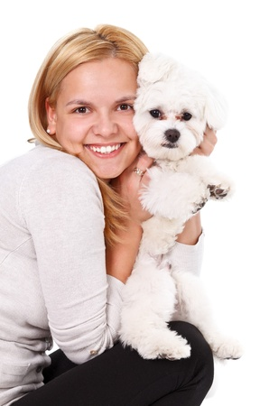 bichon bolognese: Portrait of a young beautiful woman embracing her adorable puppy  Stock Photo