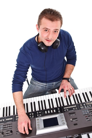 Musician looking at the camera while playing on the keyboard