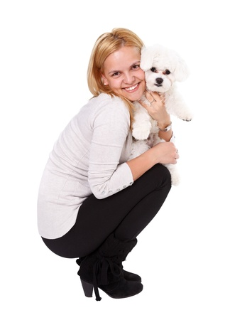 bichon bolognese: Cute girl holding a bichon dog puppy isolated over white background
