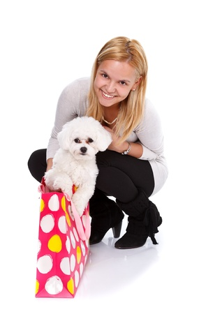 bichon bolognese: Happy girl received an adorable puppy as a gift - isolated
