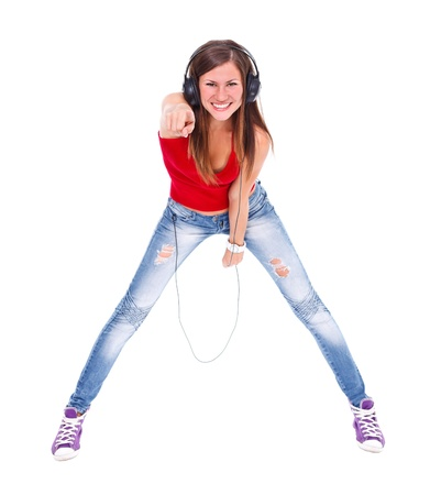 bending forward: Happy woman with headphone bending forward, pointing to camera over white background  Stock Photo