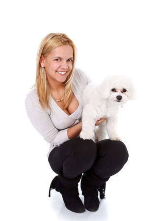 bichon bolognese: Pretty young smiling girl posing to camera with a cute white little dog