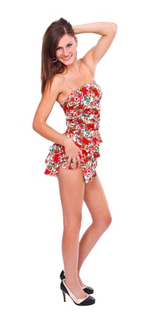 Young beautiful woman in short summer dress posing to camera - isolated  photo