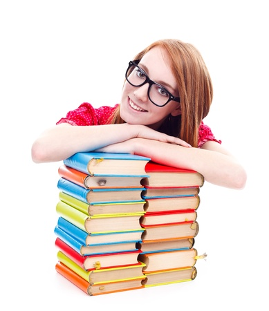 Smiling girl with black framed glasses posing to camera with stack of books isolated on white background  photo