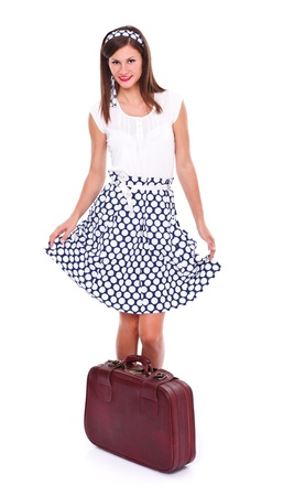 Lovely young woman posing with retro suitcase over white background.  photo