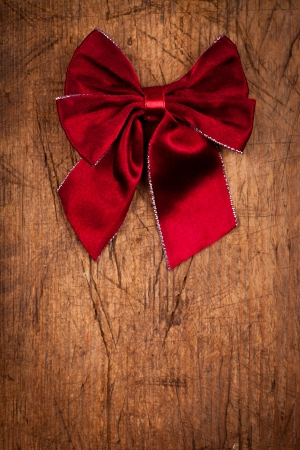 claret: Claret bow on wooden background, Christmas concept