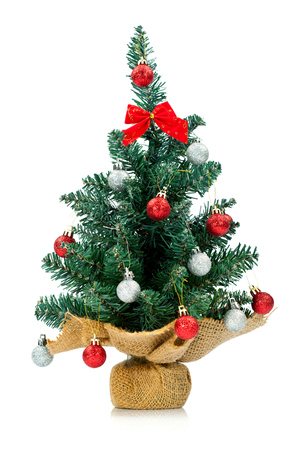 small and lovely decorated christmas tree isolated on white background photo - Small Decorated Christmas Trees