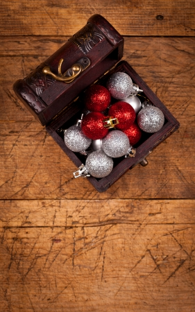tresure: Tresure chest with Christmas decorations on wooden table, above view  Stock Photo