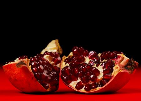 grenadine: Pieces of grenadine over red and dark background