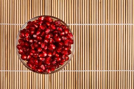 grenadine: Grenadine seeds in a glass bowl on wooden sticks