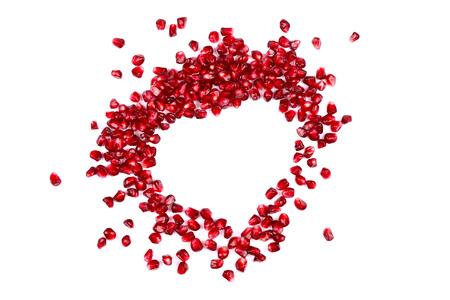 grenadine: Seeds of grenadine in shape of heart, concept