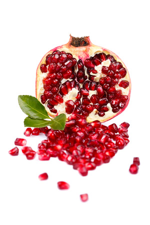 grenadine: A half grenadine with seeds over white background