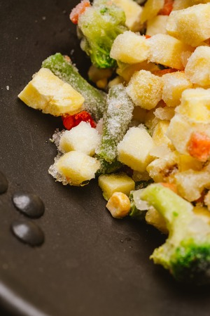 mixture: mixture of chopped vegetables and broccoli in a frying pan.