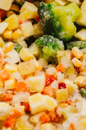 jhy: mixture of chopped vegetables and broccoli background. Stock Photo