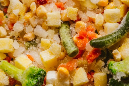 mixture of chopped vegetables and broccoli background. Stock Photo